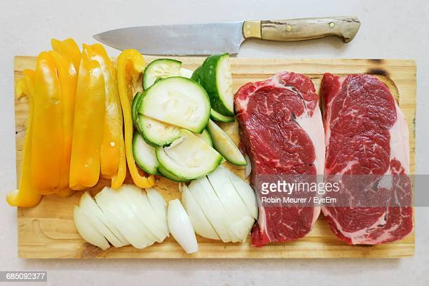 Directly Above View Of Raw Food On Cutting Board By Knife