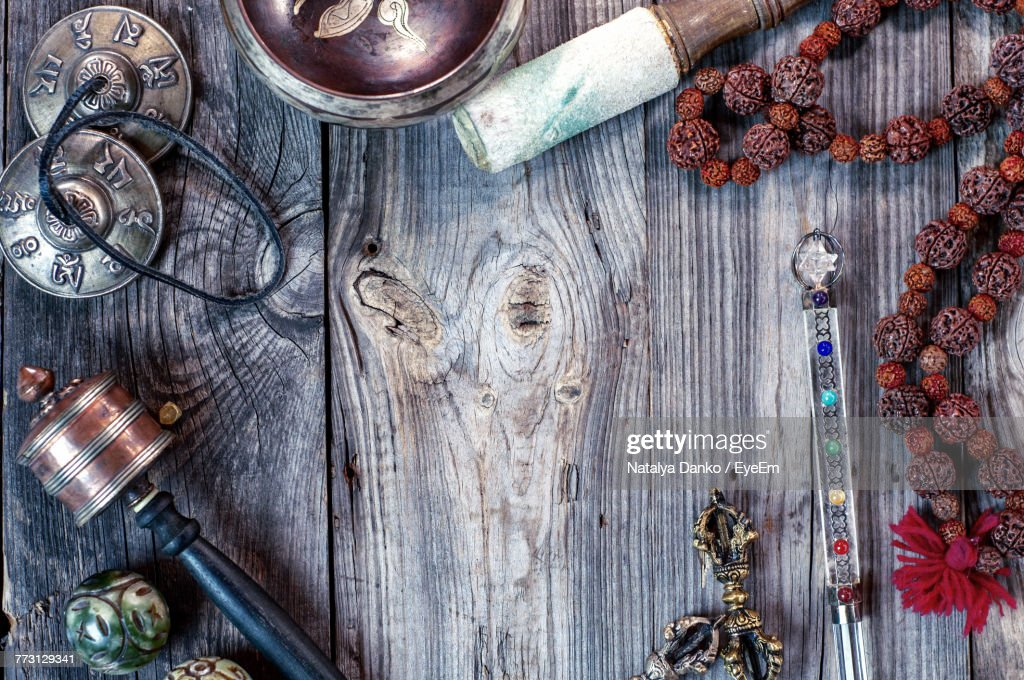 Directly Above View Of Religious Equipment On Wooden Table : Photo