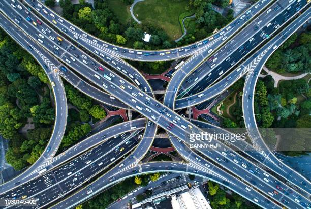 directly above view of road junction in shanghai - verkehrswesen stock-fotos und bilder
