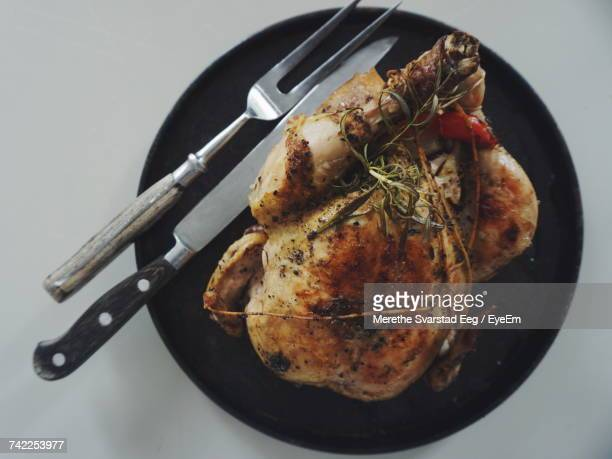 directly above view of roasted chicken in plate on table - carving knife stock pictures, royalty-free photos & images