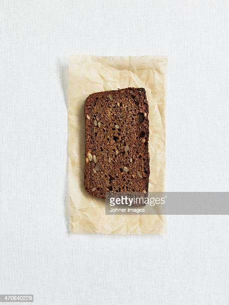 Directly above view of rye bread on paper, studio shot