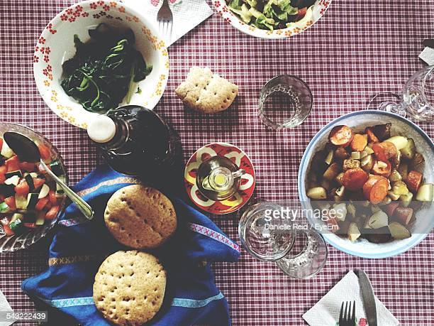 directly above view of salad and biscuits with tablewear on checkered tablecloth - danielle reid stock pictures, royalty-free photos & images