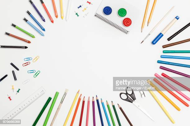 directly above view of school supplies on white background - arti e mestieri foto e immagini stock