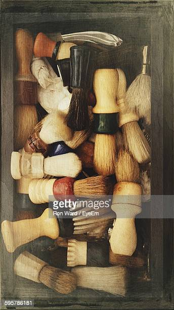 directly above view of shaving brushes in container - shaving brush stock photos and pictures