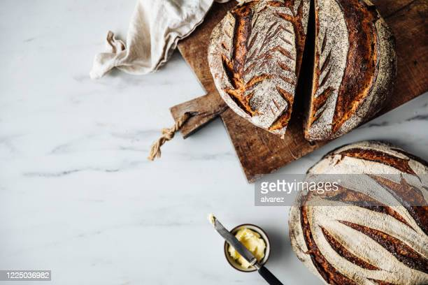 directly above view of sourdough bread and butter - freshness stock pictures, royalty-free photos & images