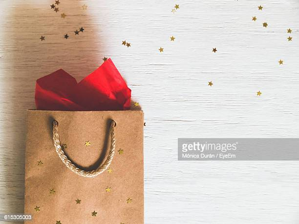 Directly Above View Of Star Shape Decorations And Paper Bags On Table