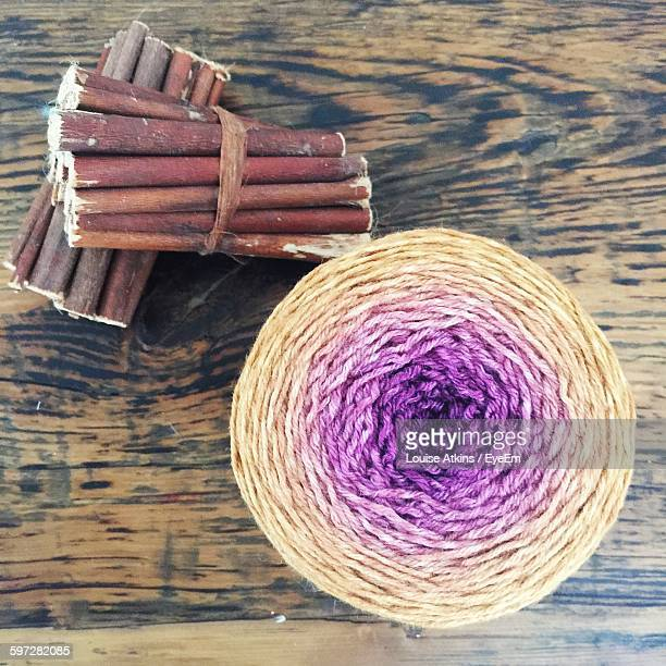 Directly Above View Of Sticks And Wool Ball On Table
