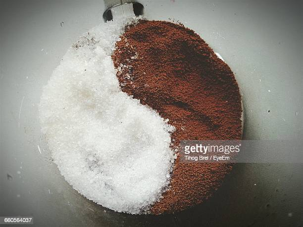 Directly Above View Of Sugar And Ground Coffee Arranged As Yin Yang Symbol