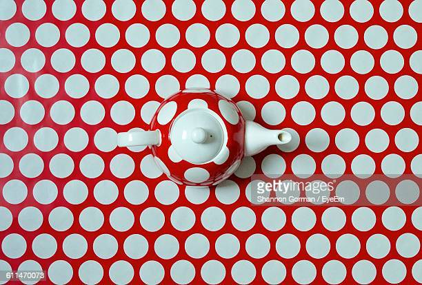Directly Above View Of Tea Pot On Polka Dot Table