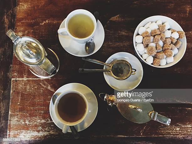 Directly Above View Of Tea With Sugar Cubes And Teapots