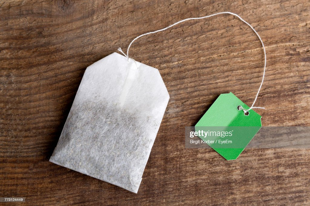 Directly Above View Of Teabag On Table : Photo