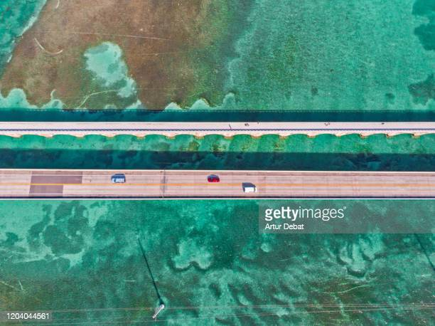 directly above view of the overseas highway in florida keys with turquoise watercolor. - two lane highway stock pictures, royalty-free photos & images