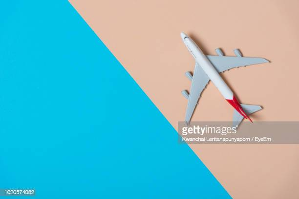 Directly Above View Of Toy Airplane Against Colored Background