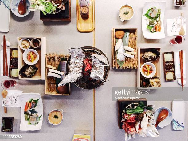 directly above view of traditional japanese dinner in ryokan - 旅館 ストックフォトと画像