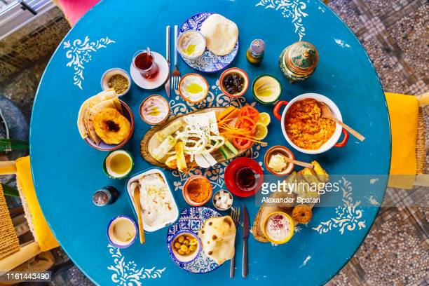 directly above view of traditional turkish breakfast in a restaurant, istanbul, turkey - イスタンブール県 ストックフォトと画像