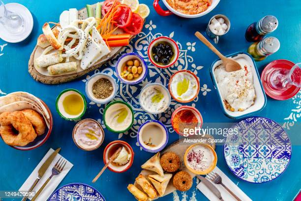 directly above view of traditional turkish breakfast served with various mezze platters - istanbul stock pictures, royalty-free photos & images
