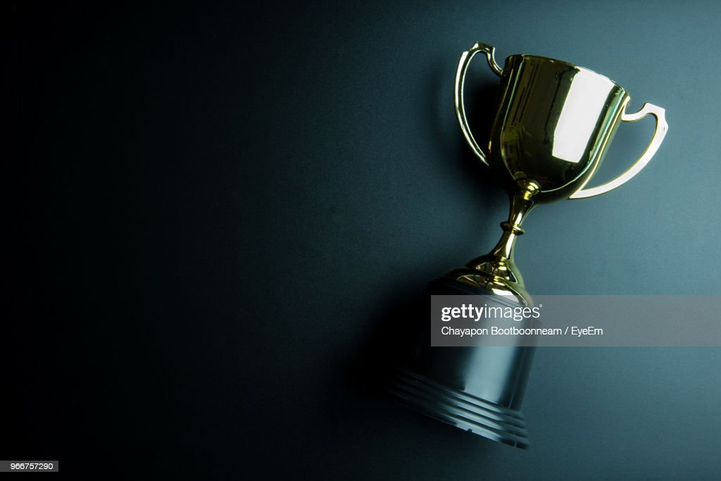 Directly Above View Of Trophy On Black Background : Stock Photo