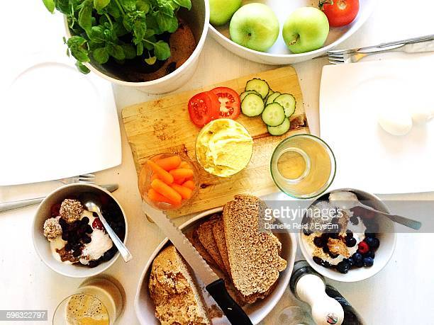directly above view of various food on table - danielle reid stock pictures, royalty-free photos & images
