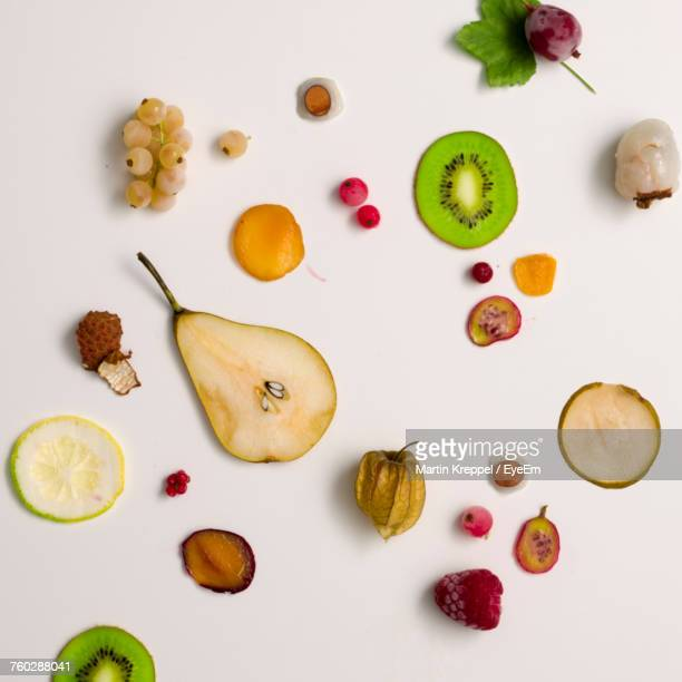 Directly Above View Of Various Fruits On White Background