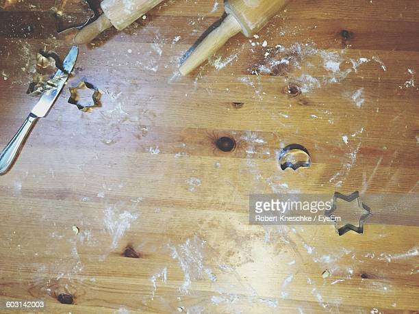Directly Above View Of Various Shape Cookie Cutters And Rolling Pin With Knife On Table