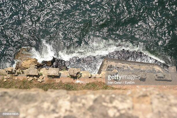 Directly Above View Of Waves Splashing On Rocks