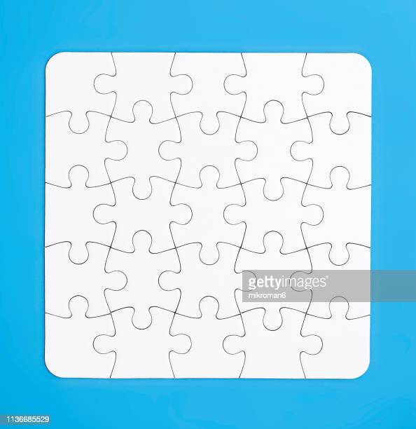 directly above view of white puzzles - puzzle stock-fotos und bilder