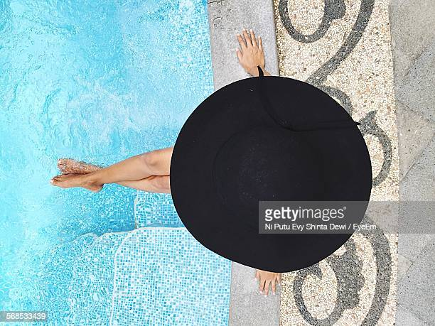Directly Above View Of Woman With Black Hat Sitting By Poolside In Ijen Suites Hotel