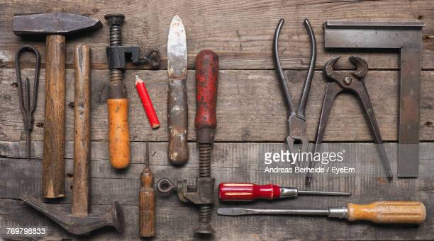 Directly Above View Of Work Tools On Wooden Table