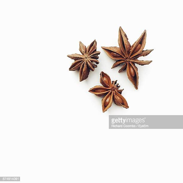directly above view star anise against white background - spice stock pictures, royalty-free photos & images