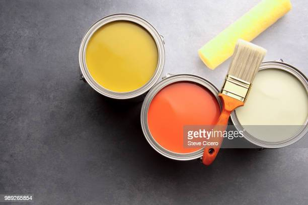 directly above view three open paint cans - image stock pictures, royalty-free photos & images