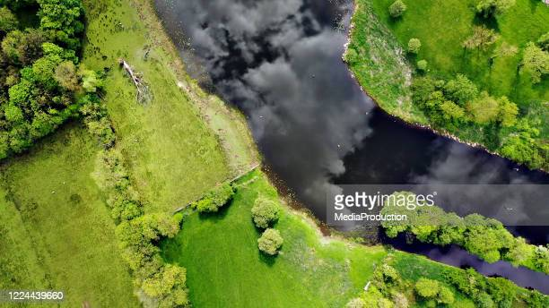 directly above views of fields with river erne in ireland - ulster province stock pictures, royalty-free photos & images