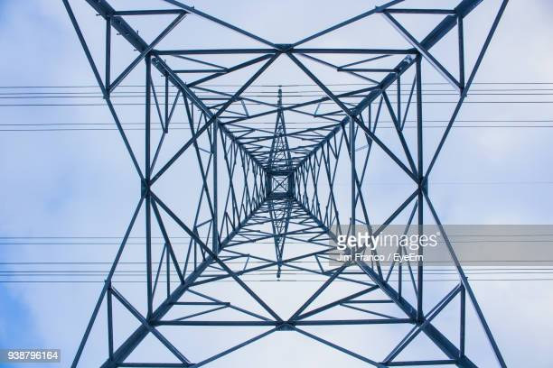 directly below of electricity pylon against sky - power line stock pictures, royalty-free photos & images
