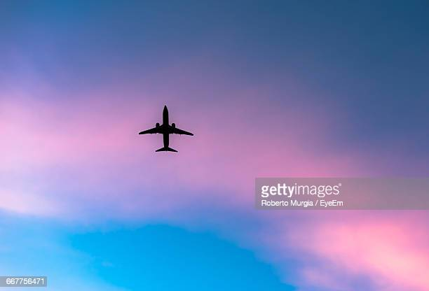 Directly Below Shot Of Airplane Against Sky During Sunset