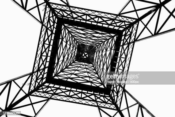 directly below shot of electricity pylon against clear sky,chandigarh,india - chandigarh stock pictures, royalty-free photos & images