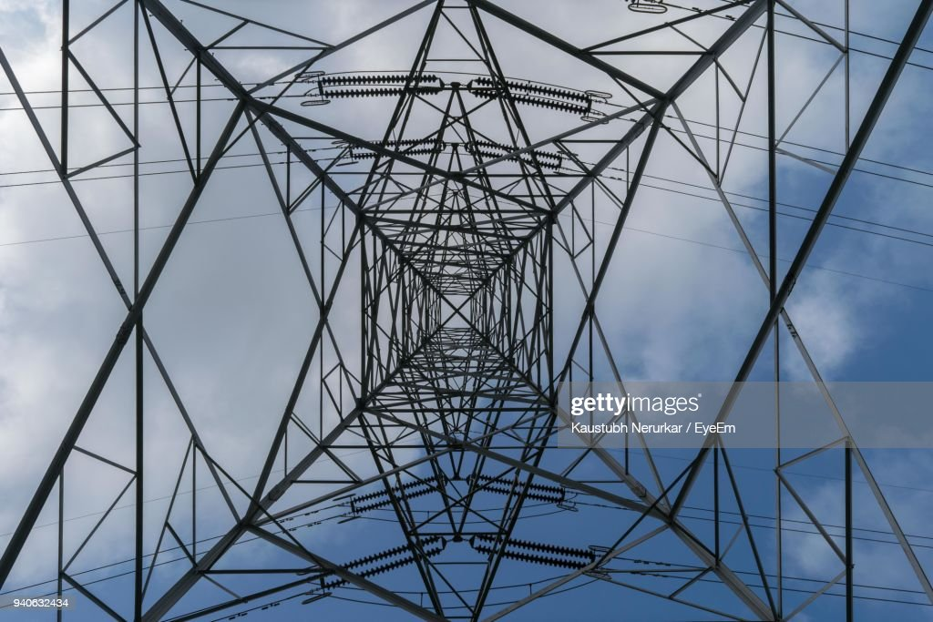 Directly Below Shot Of Electricity Pylon Against Sky : Stock Photo