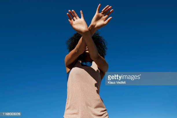 directly below shot of female athlete gesturing against clear sky - unrecognisable person stock pictures, royalty-free photos & images