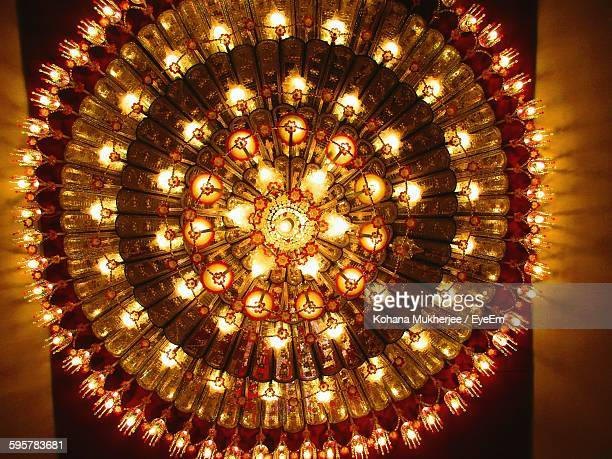 Directly Below Shot Of Illuminated Chandelier In Temple During Diwali