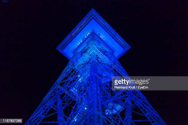 directly below shot of illuminated tower against clear sky at night - berliner funkturm stock-fotos und bilder