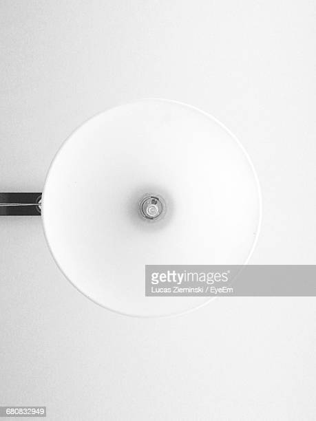 Directly Below Shot Of Lamp Against Ceiling