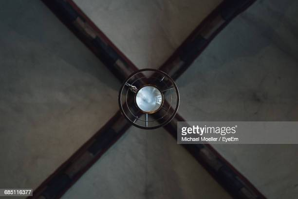 Directly Below Shot Of Lamp Hanging From Ceiling