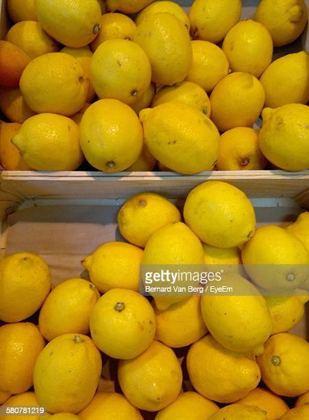 Directly Below Shot Of Lemons In Crate At Market