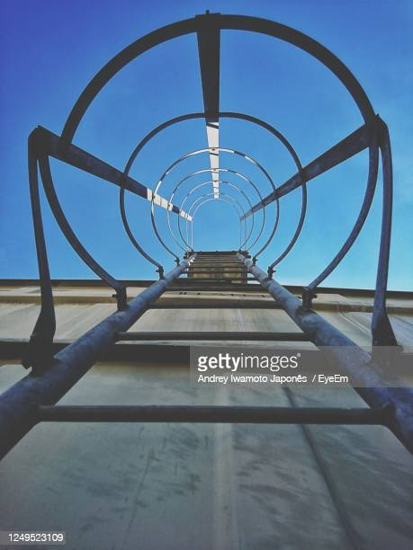 directly below shot of metallic structure against sky - japonês stock pictures, royalty-free photos & images
