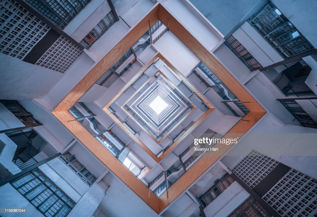 Directly Below Shot Of Modern Building Against Sky : Stock Photo