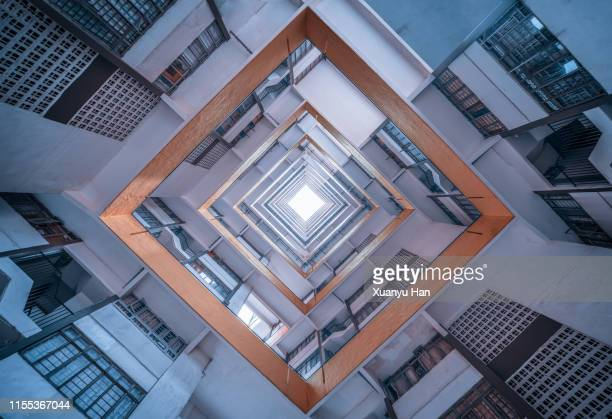 directly below shot of modern building against sky - architecture stock pictures, royalty-free photos & images