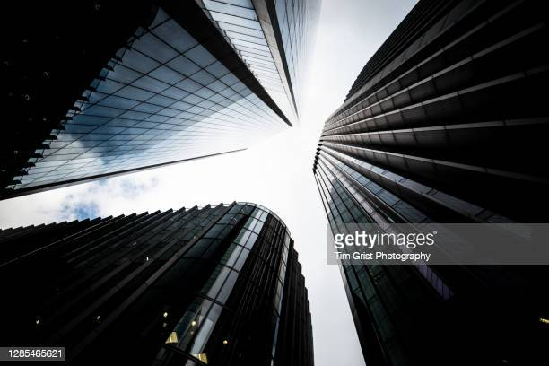 directly below shot of modern skyscrapers in the city of london - cryptocurrency stock pictures, royalty-free photos & images