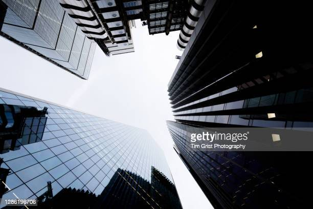 directly below shot of modern skyscrapers in the city of london - capital cities stock pictures, royalty-free photos & images