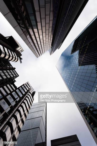 directly below shot of modern skyscrapers in the city of london's financial district. london. uk - tim grist stock pictures, royalty-free photos & images