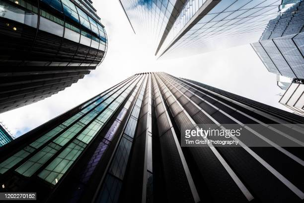 directly below shot of modern skyscrapers in the city of london's financial district. london. uk - architecture stock pictures, royalty-free photos & images