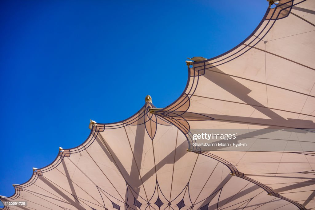 Directly Below Shot Of Parasols Against Clear Blue Sky : Stock Photo