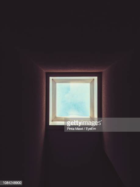 directly below shot of sky light - glass ceiling stock pictures, royalty-free photos & images